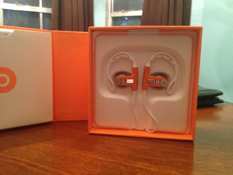 Powerbeat earpieces within their holding case and box